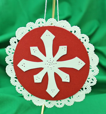 Paper Doily Snowflake Ornament hanging on display