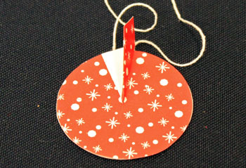 Easy Christmas Crafts Paper Pinwheel Wreath Ornament step 12 place fold on line
