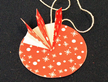 Easy Christmas Crafts Paper Pinwheel Wreath Ornament step 13 first quadrant finished